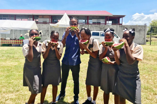 Image of students from the Micoud Secondary School participating in a Watermelon eating competition.