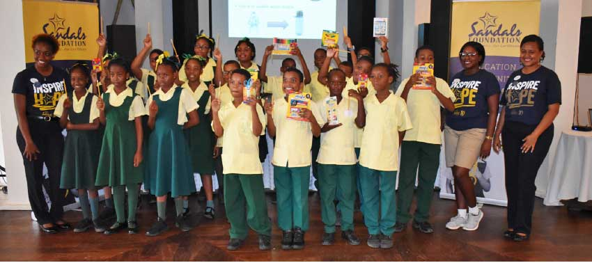 Image: Students of the Balata Primary School with Rhonda Giraudy, Public Relations Manager of Sandals (far right) and Rodesha Reid.