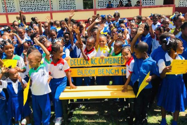 Image of students of the Delcer RC Combined School with their Buddy Bench.