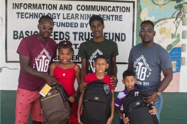 Image of Vye Twizeen Boyz with the lucky recipients.