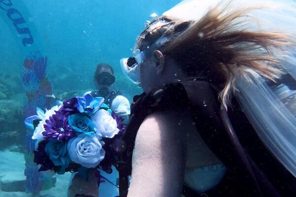 Image of Julie Gilchrist at her underwater wedding