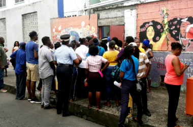 Image: A crowd of parents outside the Ave Maria Girls' Infant School on Monday.