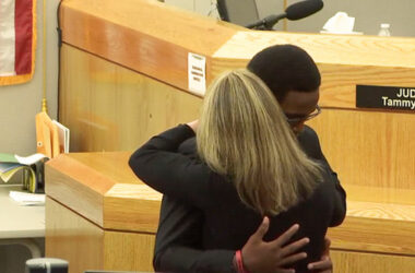 Image of Botham's younger brother Brandt embracing Amber Guyger
