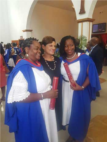 Image of Delia Cuffy-Weekes and Natasha Jervier with Pro Vice-Chancellor and Principal of the Open Campus, Dr Luz Longsworth.