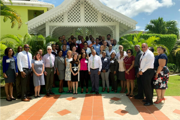 Image: Facilitators and participants of the 'Enhancing the Climate Science Basis of GCF Funded Activities Workshop' at Bay Gardens.