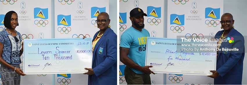 Image: (L-R) National athletes Levern Spencer and Albert Reynolds receiving their cheques from SLOC President,  FortunaBelrose. (Photo: Anthony De Beauville)