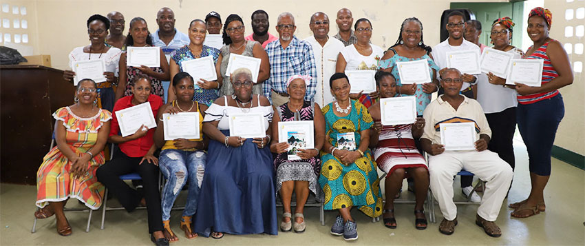 Image: Participants with their certificates of completion.