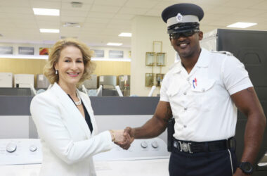 Image: Make It Happen's Raquel DuboulayChastanet makes donations of washing machines to various police stations island-wide.