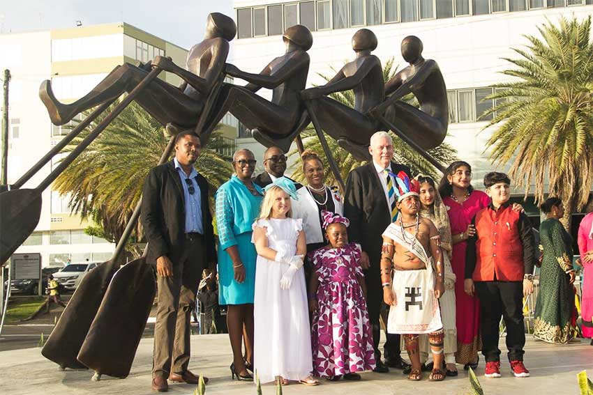 "Image of Sculptor Jallim Eudovic with Government representatives and other participants in the unveiling of the ""All In"" Monument on the Castries Waterfront."