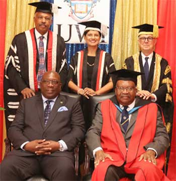 Image: Standing (L-R) Vice-Chancellor Professor Sir Hilary Beckles, Pro Vice-Chancellor and Principal Dr. Luz Longsworth and Chancellor Robert Bermudez with Governor-General of St Kitts and Nevis Sir TapleySeaton (seated at right) and Dr Timothy Harris, Prime Minister of St Kitts and Nevis.