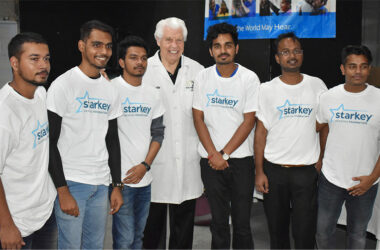 William F. Austin (centre) with volunteers of Starkey Hearing Foundation.