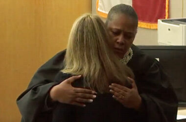 Image: Judge Tammy Kemp handed Amber Guyger a Bible and hugged her at the conclusion of the trial.