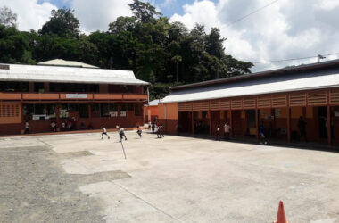 Image: an almost empty school play ground at the Gordon Walcott Methodist Combined