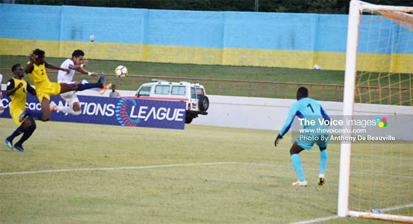 Image: A scary moment for Saint Lucia defense; Cuthbert Modeste in national colours. (PHOTO: Anthony De Beauville)