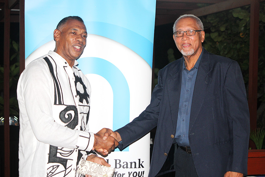 Image of Adrian Augier (left) and Johnson Cenac, outgoing directors of 1st National Bank.