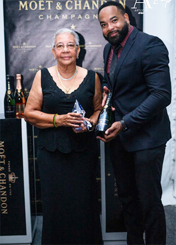 Image: Dr Charmaine Gardner (left) after being presented with the Lifetime Achievement Award.