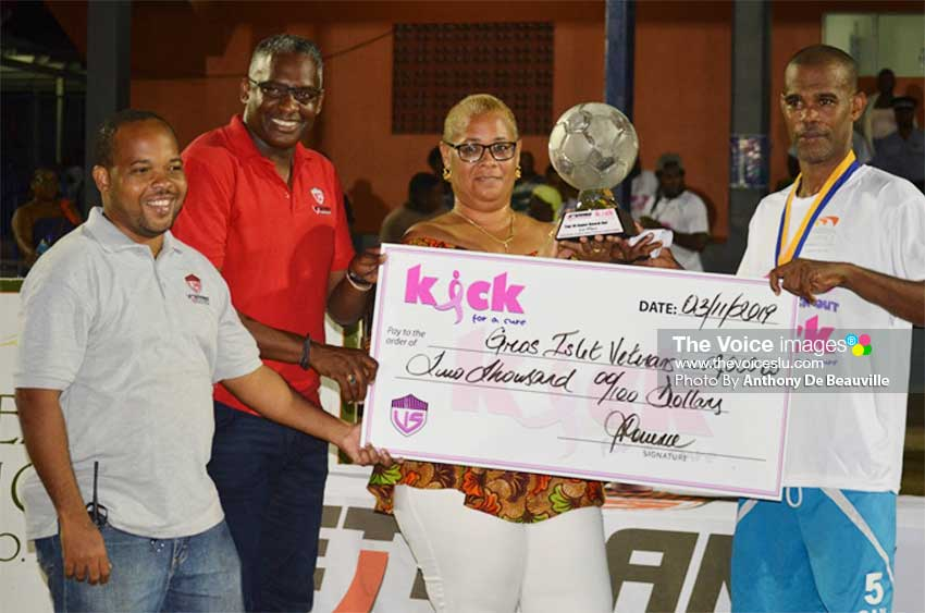 Image: (L-R) Garvin Niles – Tournament Director, Alvin Malaykhan – CEO Veterans In Sports Inc., Allison Belizaire Cancer patient  and Sherman  Sylvester -  Captain Gros Islet Veterans Football Team. (PHOTO: Anthony De Beauville)