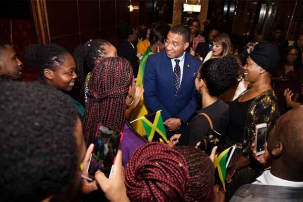 Image: Jamaican students from The University of the West Indies - China Institute of Information Technology (UWI-CIIT) greet Prime Minister of Jamaica, the Most Honourable Andrew Holness, ON, MP, during a private reception at the Mandarin Oriental, Shanghai (China) on November 3, 2019.