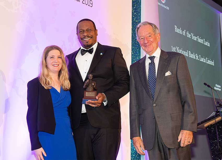 Image of Managing Director Johnathan Johannes (center) collecting the Bracken Bank of the Year Award on behalf of 1st National Bank.