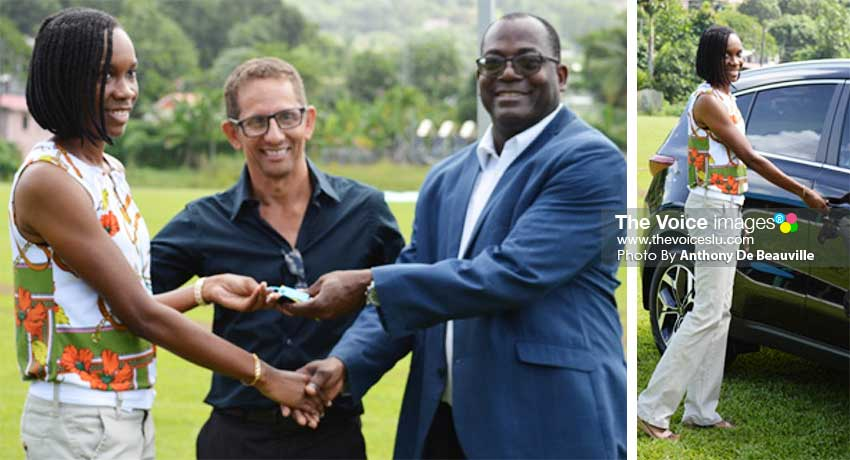 Image: (L-R) Levern Spencer receiving the keys from Sports Minister Edmund Estephane, while Larry Bain looks on. (PHOTO: Anthony De Beauville)