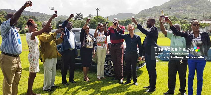 Image: Minister of Sports and Ministry officials, Kia representative and well wishers hail three cheers and a toast of non-alcoholic champagne to the high jump Queen, Levern Spencer. (PHOTO: Anthony De Beauville)