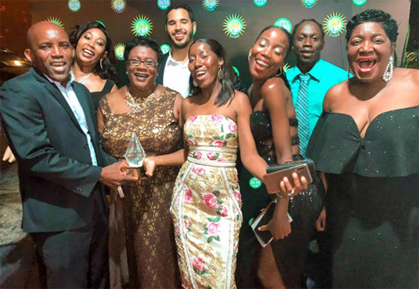 Image: Waltrude Patrick, General Manager of Bay Gardens Beach Resort & Spa (third from left), and Berthia Parle MBE, Retired General Manager (far right), celebrate with team members at the St Lucia Business Awards ceremony last weekend.