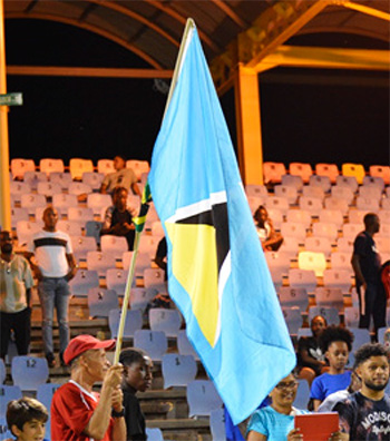 Image of a man at the game holding a Saint Lucian flag