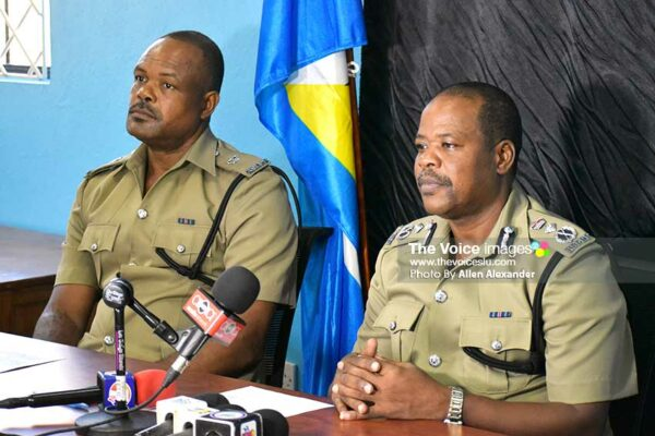 Image: Left to right: George Nicholas, Superintendent of Police, and Severin Moncherry, Police Commissioner addressing media personnel yesterday. [PHOTO: Allen Alexander]
