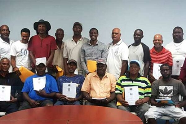 Image: Group of contractors that signed contracts for Micoud South Drains on January 17, 2020 pictured with Honourable Guy Joseph, Minister for Economic Development, Housing, Urban Renewal, Transport and Civil Aviation (far right) under which the DVRP falls and his Permanent Secretary, Mr. Claudius Emmanuel (far left) together with members of the DVRP team.