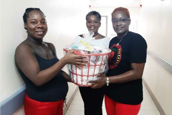 Image of Nadia Aurelien receiving her goodwill hamper.