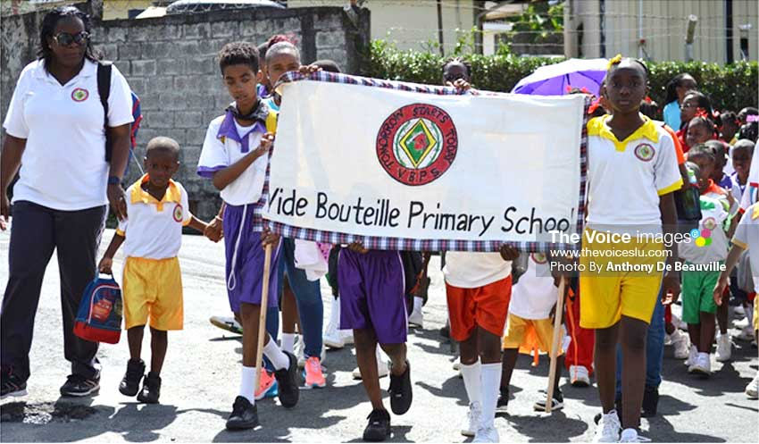 Image: Vide Bouteille Primary School Principal Lyrill Arthur Stanislaus (far left) takes charge of her troop. (Photo: Anthony De Beauville)