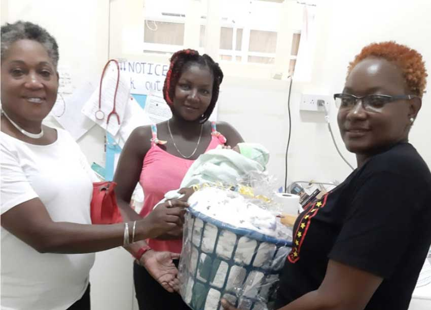 Image of Virgil Thomas receiving her goodwill hamper.