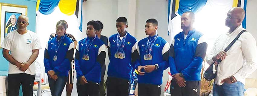 Image: (L-R) SLAF President – Eddie Hazell, Naima Hazell, Ethan Hazell, Karic Charles, Tristan Doville and Team Manager – Martin Dorville taking in some of the congratulatory messages. (PHOTO: SM)