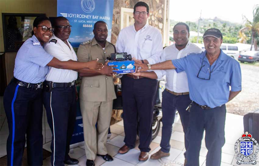 Image: IGY Rodney Bay Marina representatives presenting the new marine VHF radio to police officers from the Gros Islet Police Station.