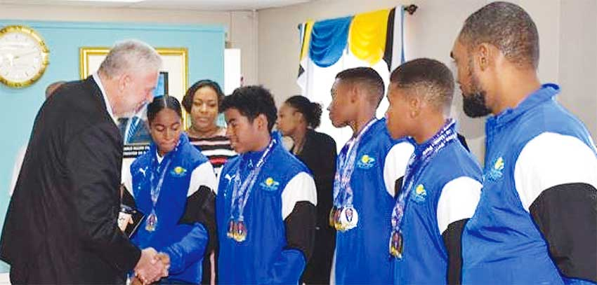 Image: Saint Lucia Prime Minister chitchart with swimmers on arrival at GLFCA VIP Lounge. (PHOTO: SM)