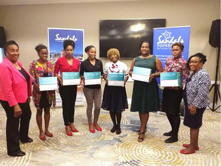 Image: Sheila Serville (extreme left), representatives of the six recipient institutions, and Clara Paul (at right).