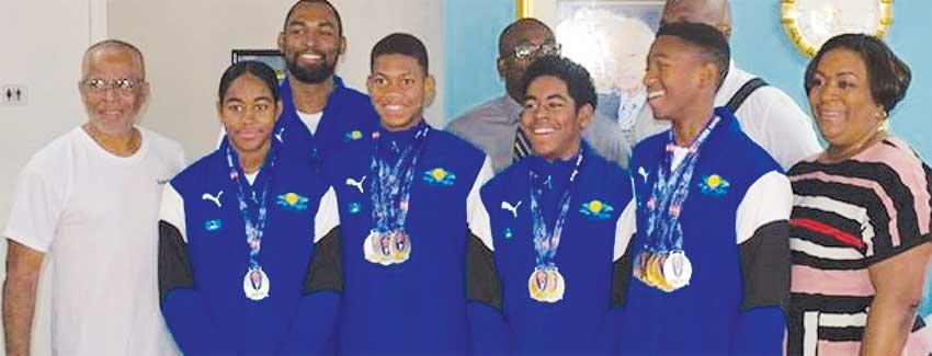 Image: Photo moment for  Team Saint Lucia with Sports Minister - Edmund Estaphane and DPS - Liota Charlemagne -  Mason. (PHOTO: SM)