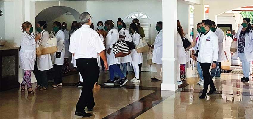 Image of Cuban doctors arriving at Sandals Regency La Toc Golf Resort & Spa.