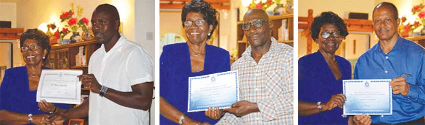 Image: (L-R) Dame Pearlette Louisy presenting certificates to St Rose Jacobie, Urban Augustin and Jeremiah Louis Fernand. (PHOTO: Anthony De Beauville)