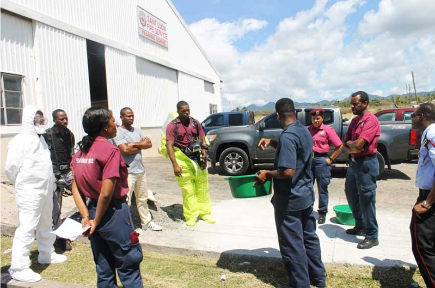 Image: Training of first responders on the method of proper decontamination of personnel equipment at the Fire Training School in Vieux Fort.