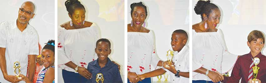 Image: (L-R) ) Some of the young aspiring footballers receiving their awards. (PHOTO: Anthony De Beauville)