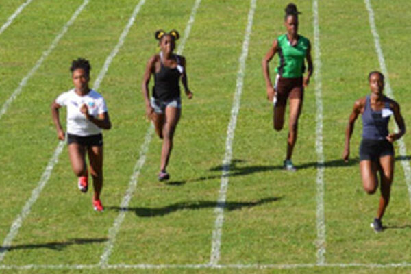 Image: First from left, Julien Alfred made light work of the field in the ladies 60 metres with a time of 7.97 seconds. (PHOTO: Anthony De Beauville)