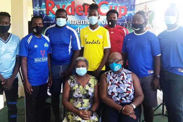 Image: FRONT ROW – Photo moment for Linda Charlery (Andre's Mother) and Parliamentary representative for Micoud North, Dr. Gale Rigobert; (BACK ROW) representatives from the participating teams. (PHOTO: ZG)