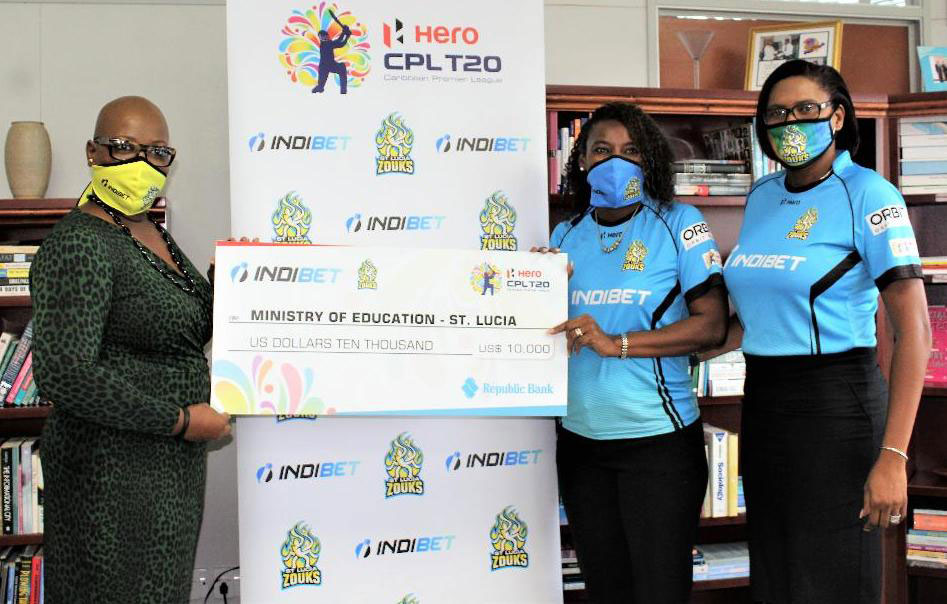 Image: (l-r) Minister for Education, Gale Rigobert receiving the US$10,000 dollars from Saint Lucia Zouks and Indibet representative, Sue Monplaisir (Photo: SM)