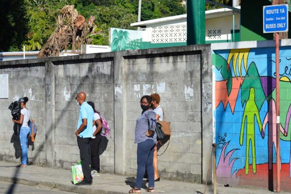 Image: Commuters waiting for a bus at an empty Gros Islet bus terminal yesterday.