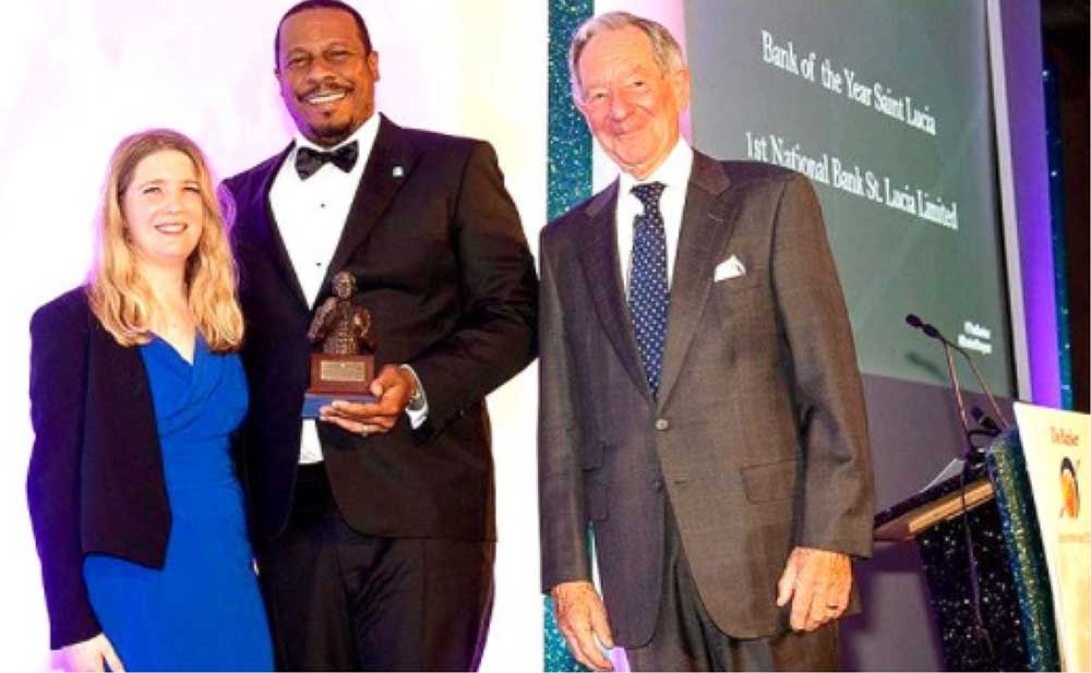 Image of Mr Johnathan Johannes (centre) receiving the award for Saint Lucia on behalf of 1st National St. Lucia Limited at the Banker Magazine's Bank of The Year 2019 Awards.