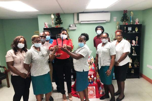 Image of Ms. S. Benjamin & PCD Sales Team Celebrating their award