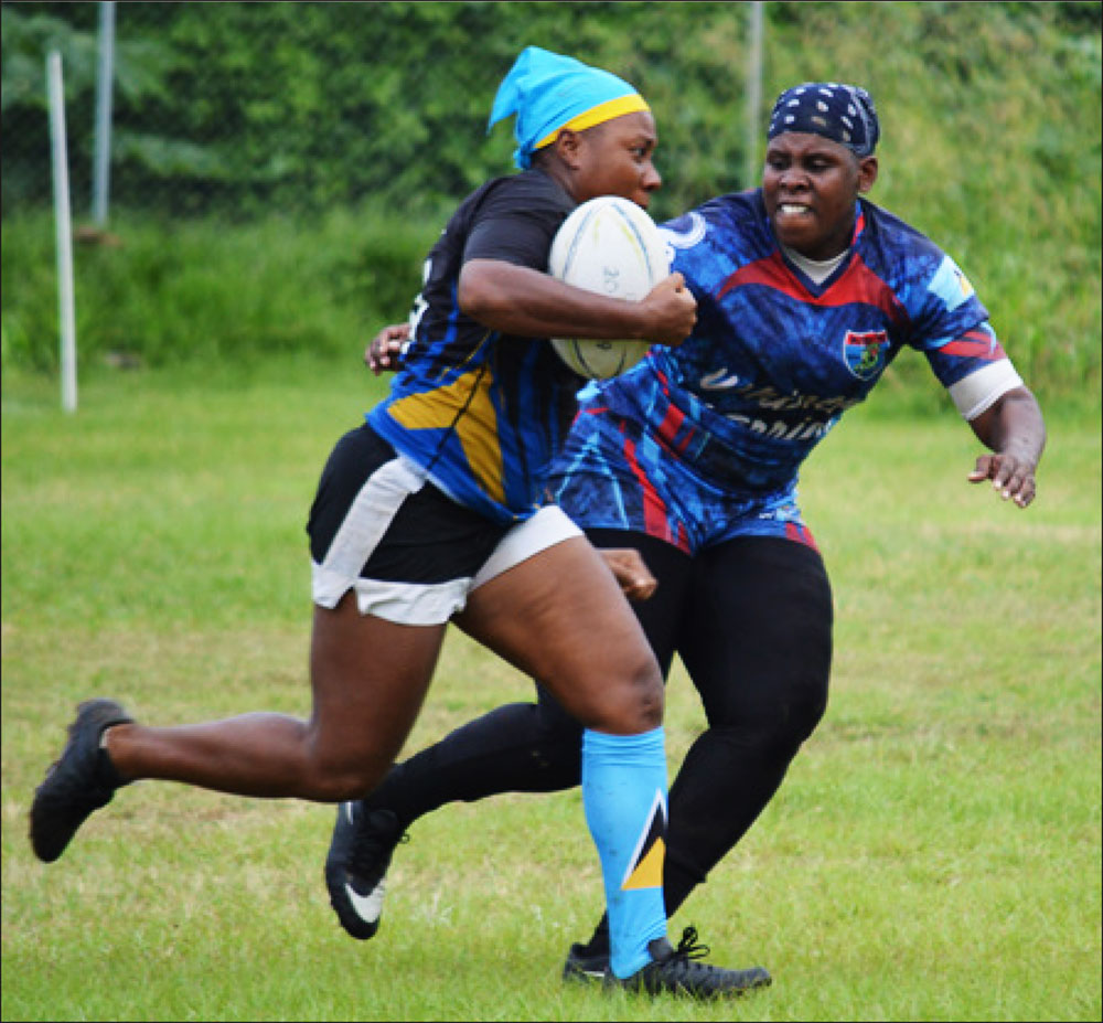 Image: Renetta Fredericks (Rogues) with ball in hand is challenged by Senetta Viger (Whiptail Warriors). (PHOTO: Anthony De Beauville)