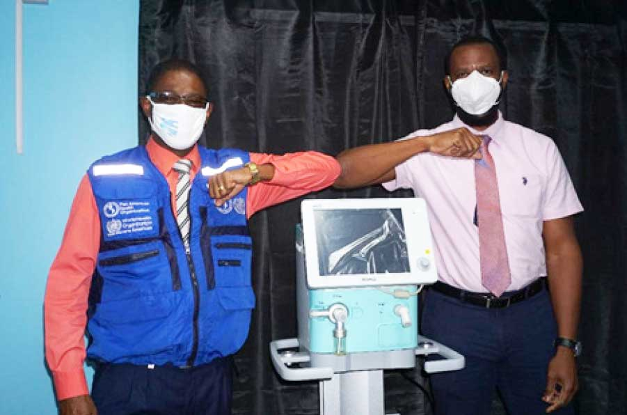 Image: Right: Mr. Benson Emile, Permanent Secretary, Department of Health and Wellness, Left: Mr. Reynold Hewitt, PAHO Country Programme Specialist