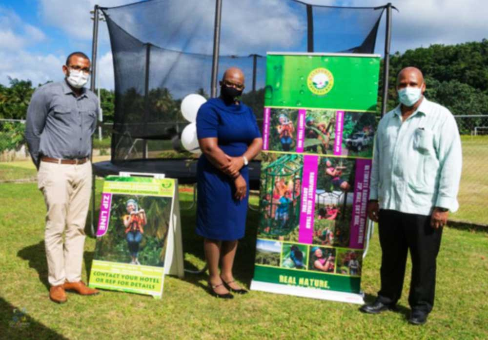 Image of From L-R, Raymond, Education Minister Rigobert and District Rep. Joseph.